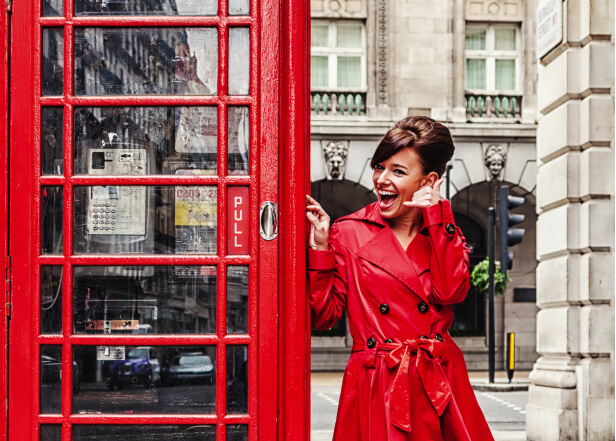 woman at a red phone booth
