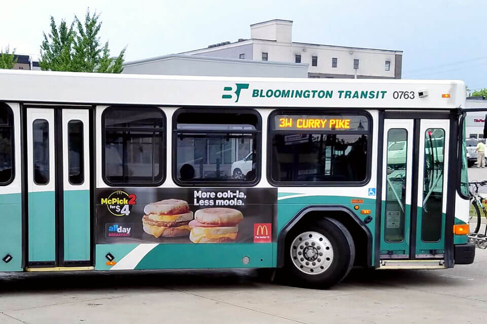 transit advertising with King bus signage