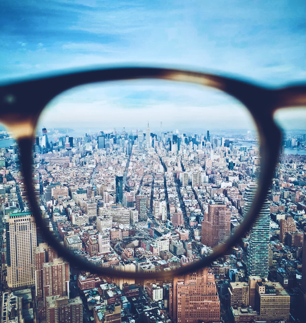 Eyeglasses looking through to city
