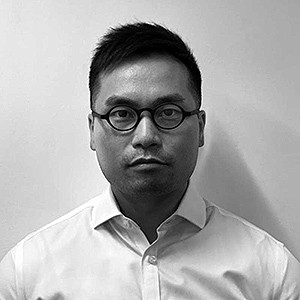Black and white portrait photo man wearing white shirt.