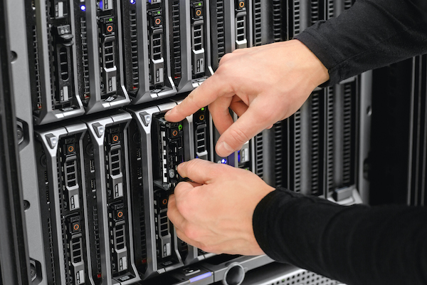 Image of hands working in a server rack