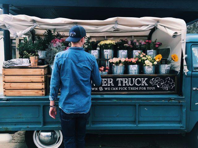 Man shopping at flower truck