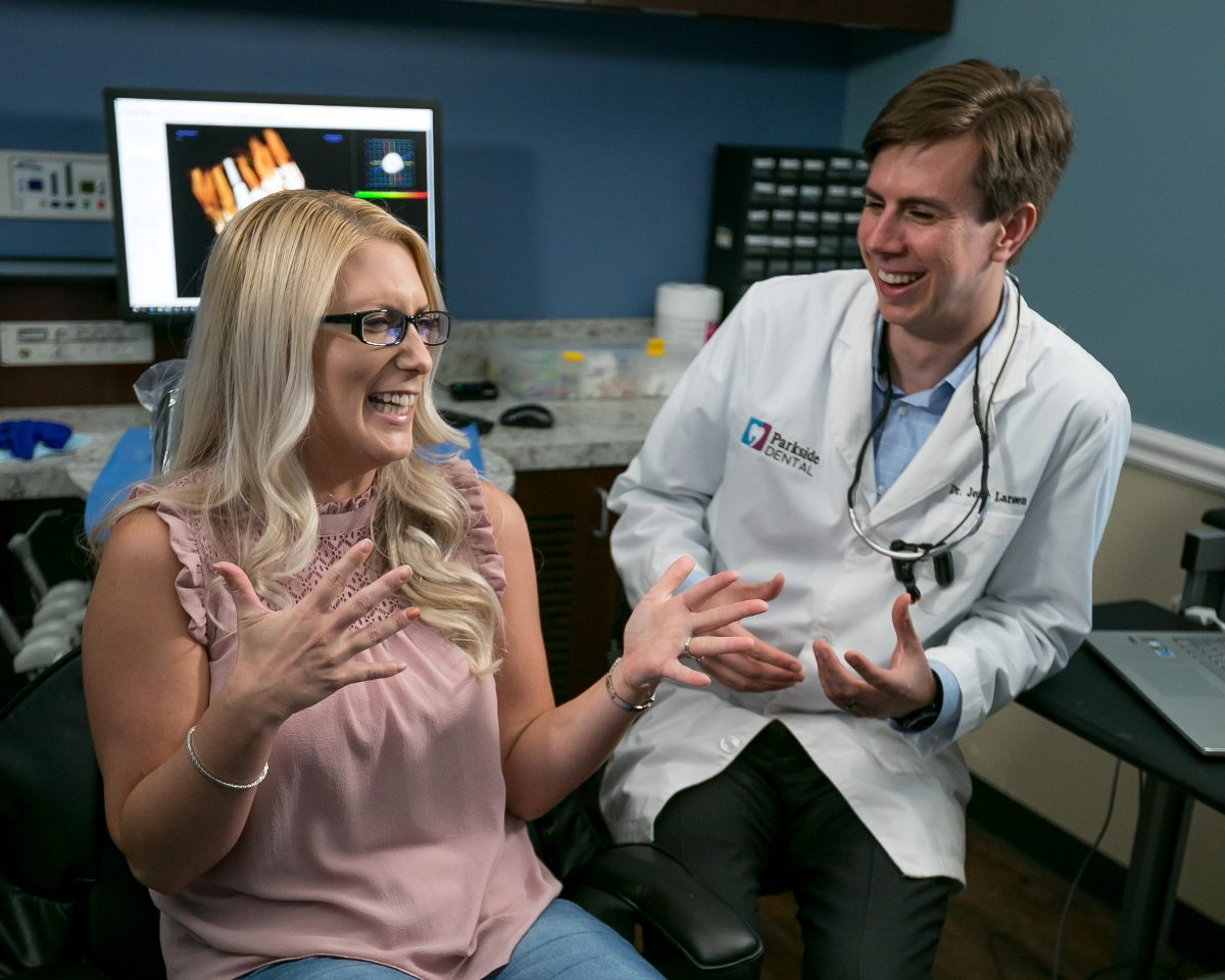 Dr. Larsen with a patient