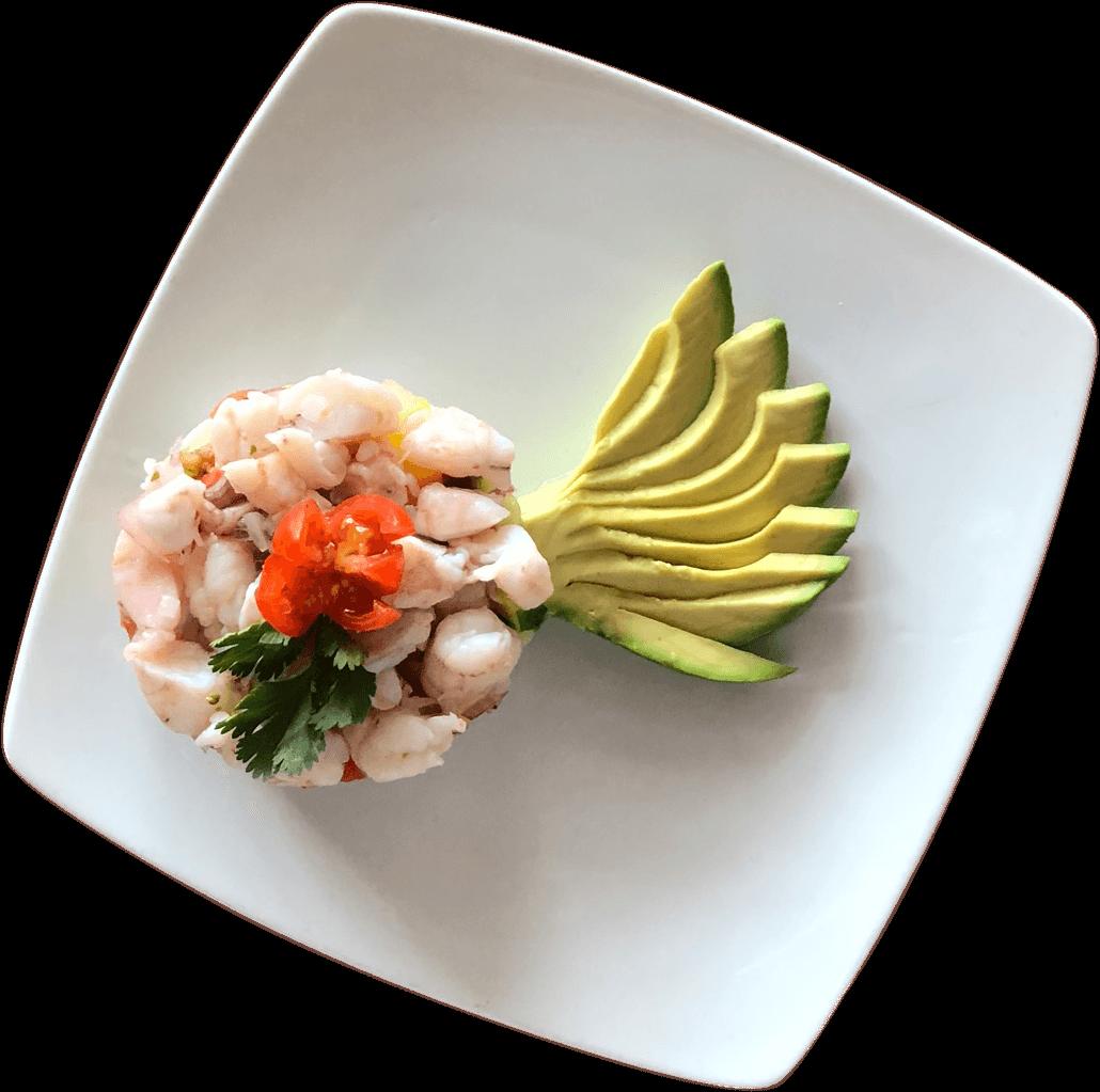 La Carreta's ceviche with shrimp and avocado on a plate.
