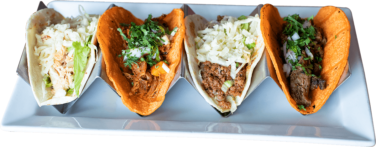 La Carreta's chicken, pork, beef and steak tacos on a plate.