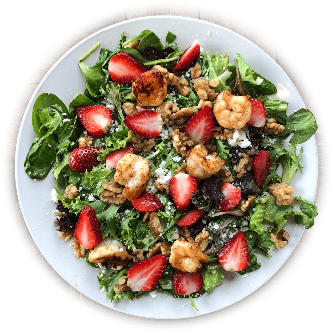La Carreta's strawberry salad with shrimp on a plate.