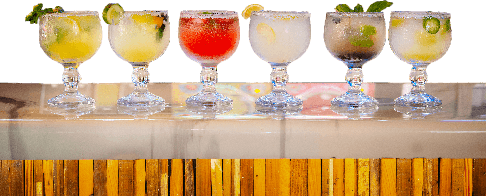 Row of colorful La Carreta margaritas on the bar.