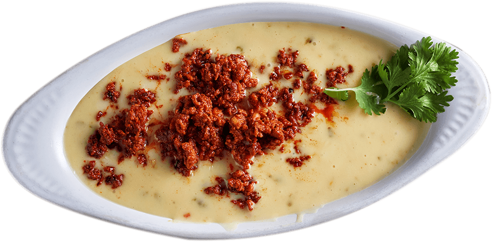 La Carreta's choriqueso dip with tortillas on a plate.