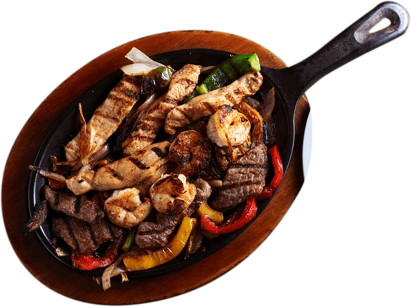 La Carreta's sizzling steak fajitas on a skillet.
