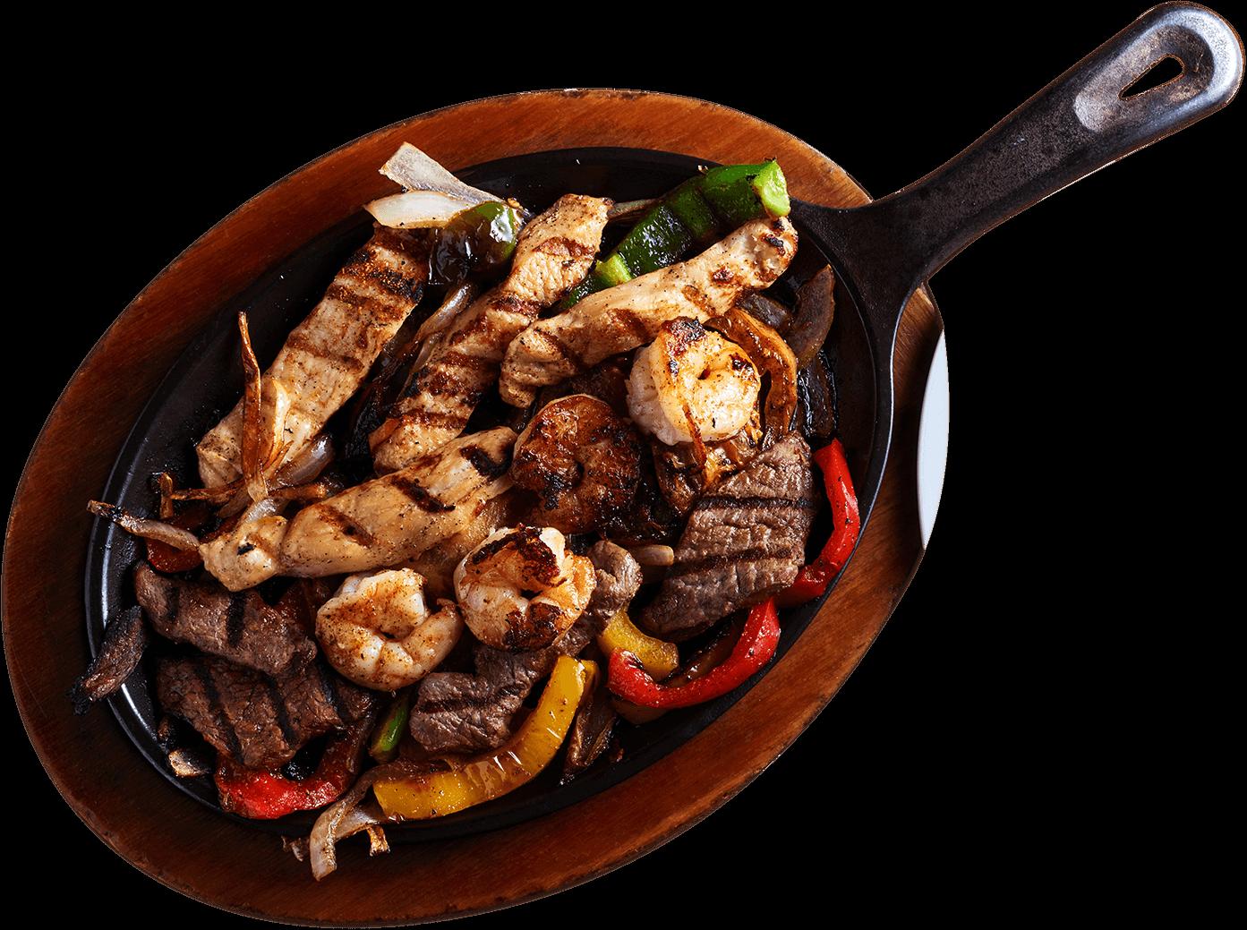 La Carreta's sizzling steak fajitas on a skillet.