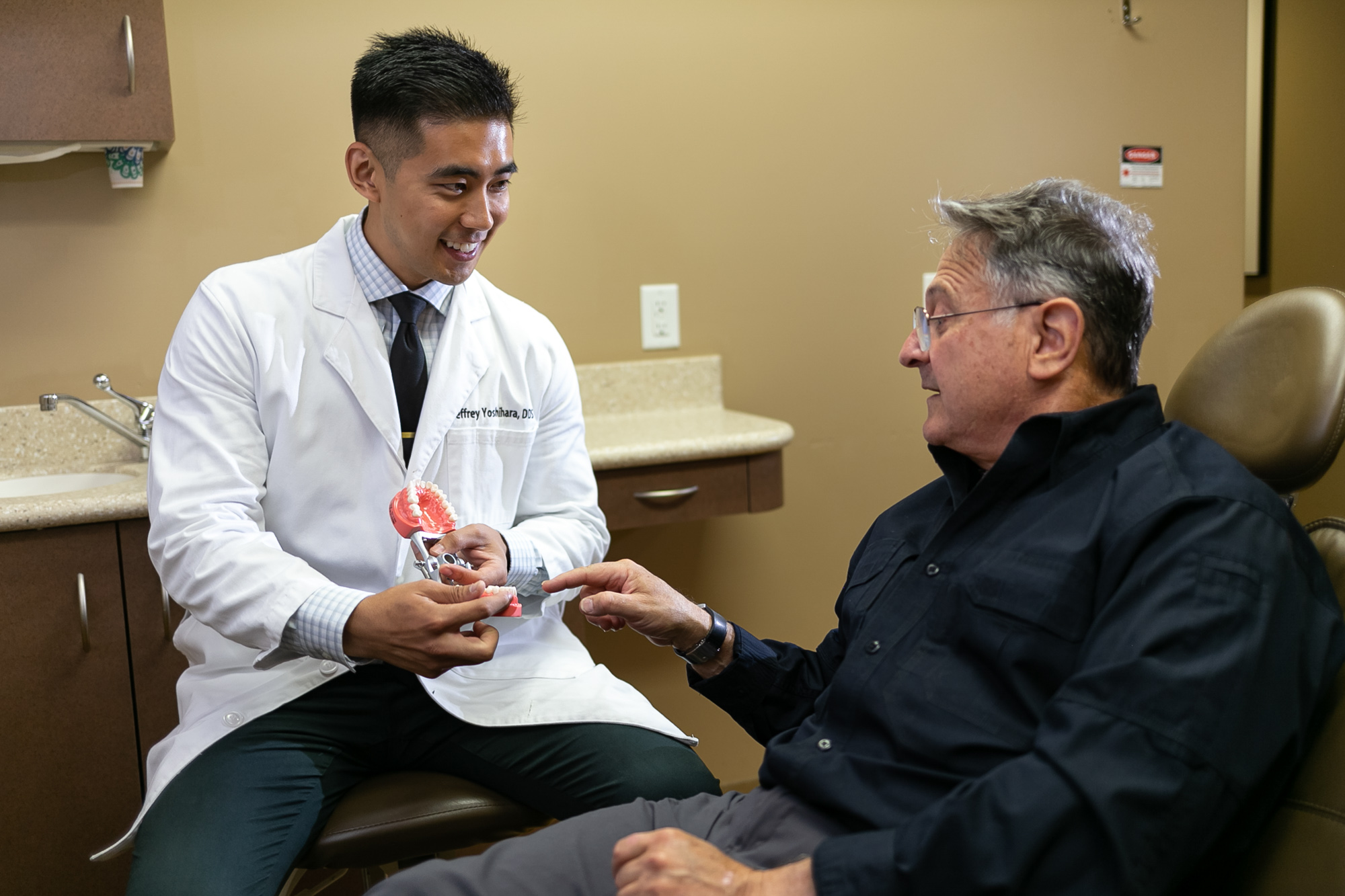 Dr. Jeff Yoshihara giving a implant consultation to patient in Mountain View