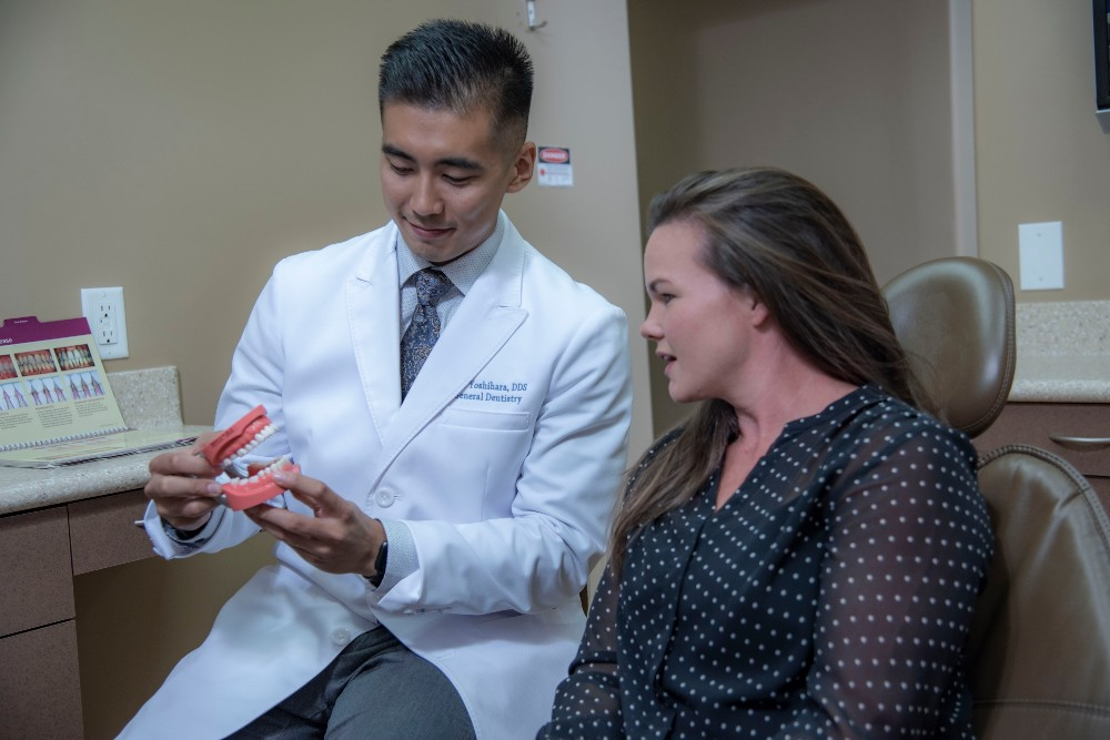 Dr. Jeff Yashihara discussing veneers with a patient