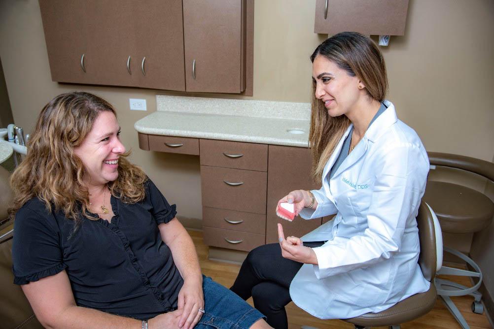 Dr. Haleh Fazeli discussing veneers with a patient