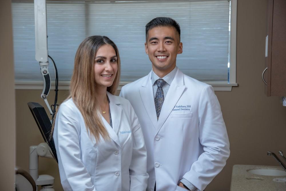Dr. Jeff Yoshihara and Dr. Haleh Fazeli smiling