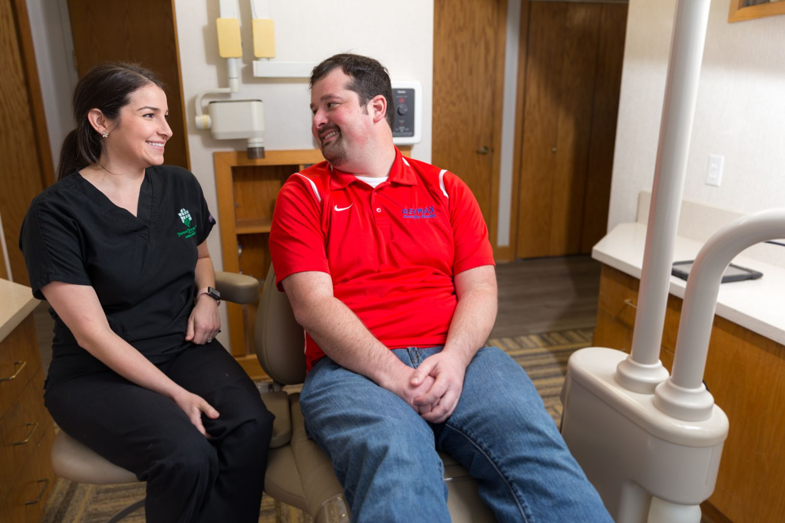 Dental Assistant smiling with patient