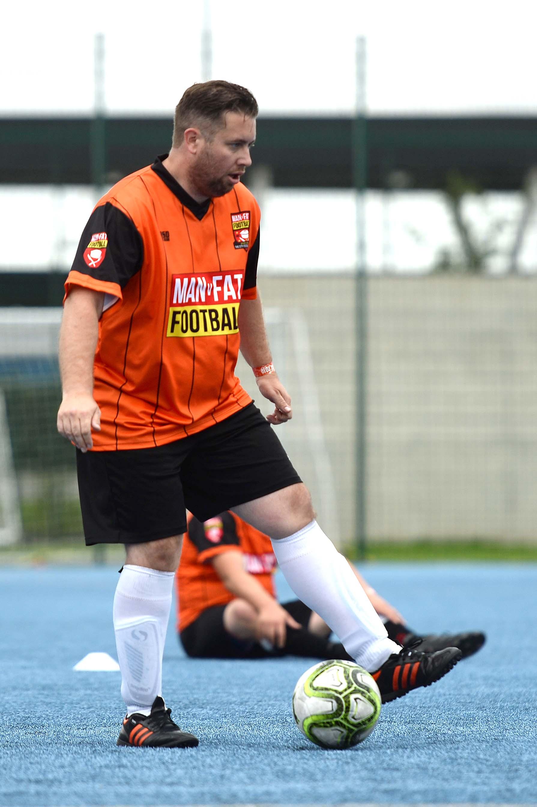 MANvFAT Footballer on the ball