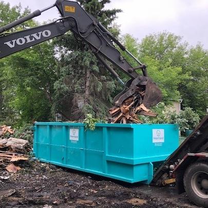 Demolition services using Heartland Disposal bins