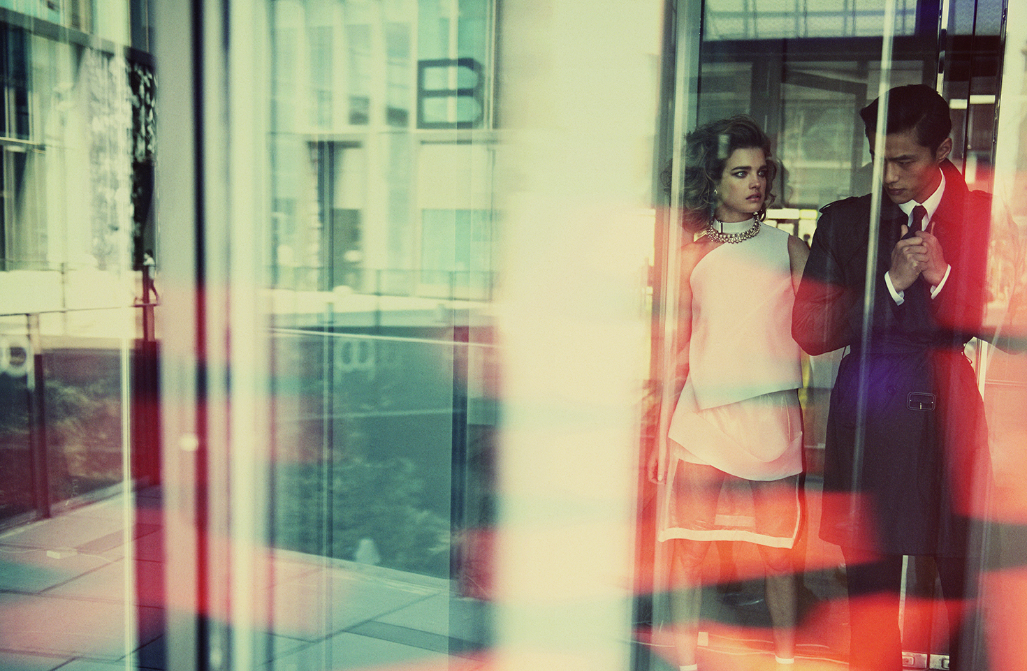 A stylish image of a couple in a hotel lobby