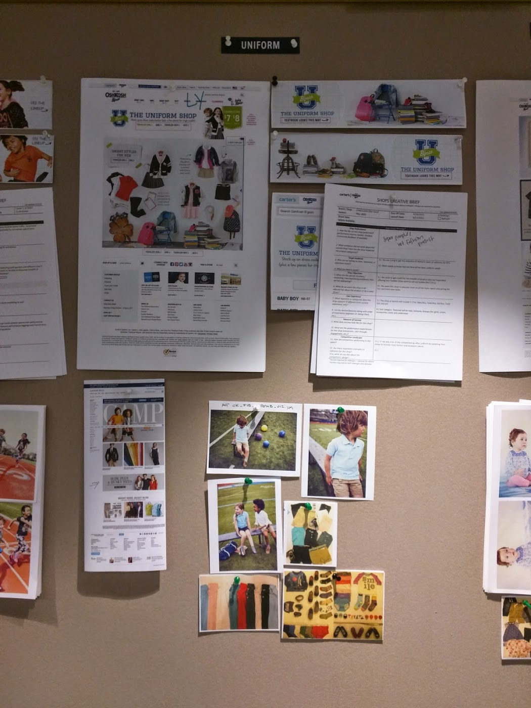 A well-lit corkboard featuring printed concepts with note for various email campaigns, including different photography options and clothing laydown shots