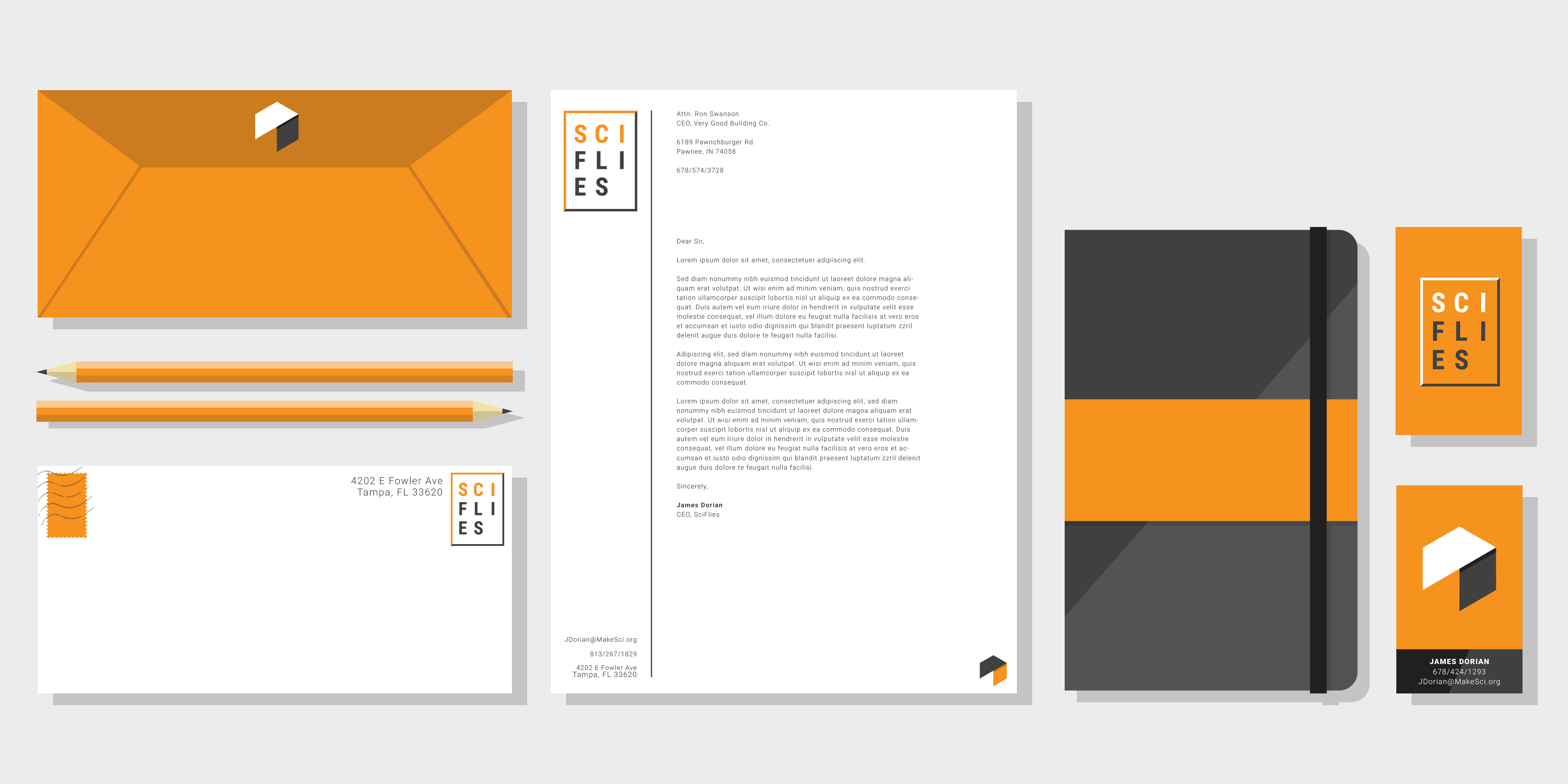 A mockup of different stationary for the brand, featuring rich oranges and deep greys. It includes a letter, letterhead, pencils, notebook, and business cards.