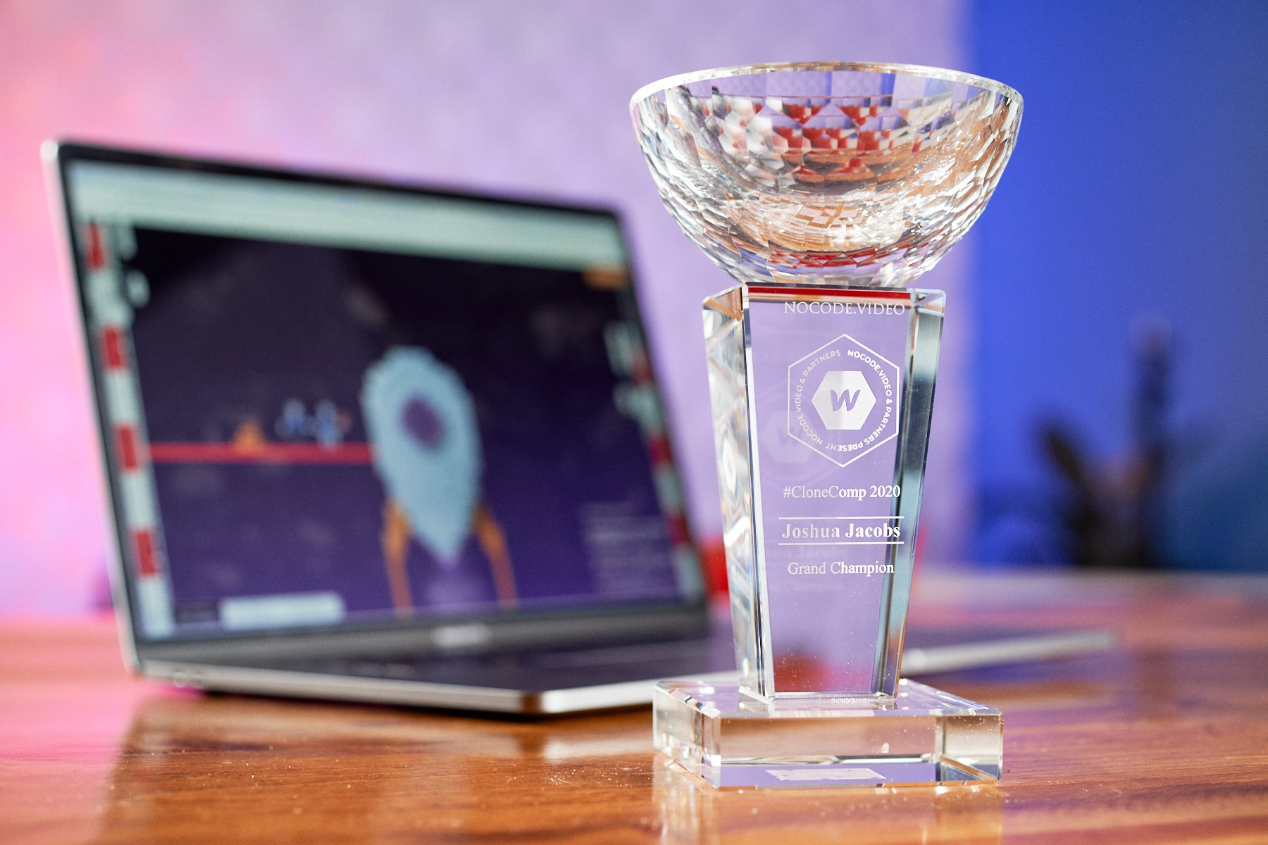 """A sick crystal trophy with the words """"Joshua Jacobs"""" on it"""