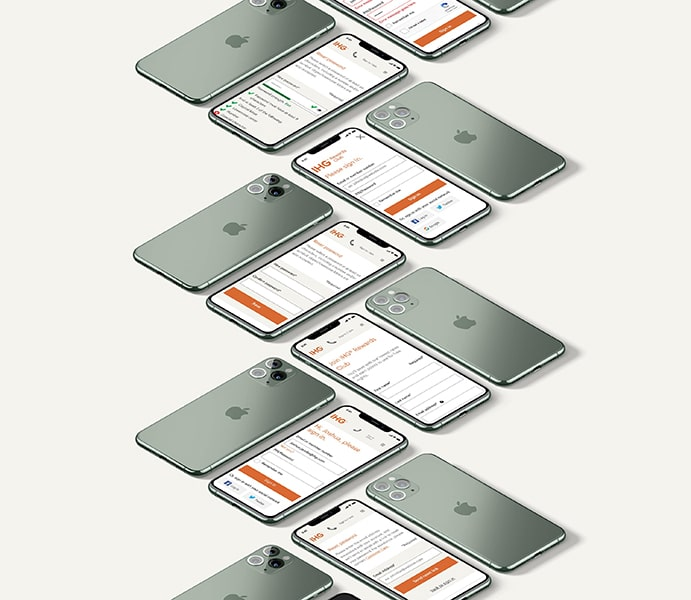 An arrangement of iPhones displaying the IHG homepage