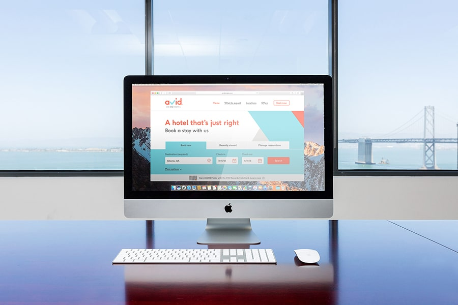 A desktop computer which showing the website homepage of avid hotels