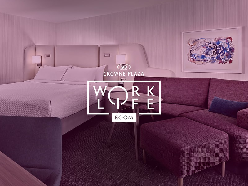 A stylized photo of the Worklife room featuring a comfortable bed and modern furniture with an old logo laid on top.