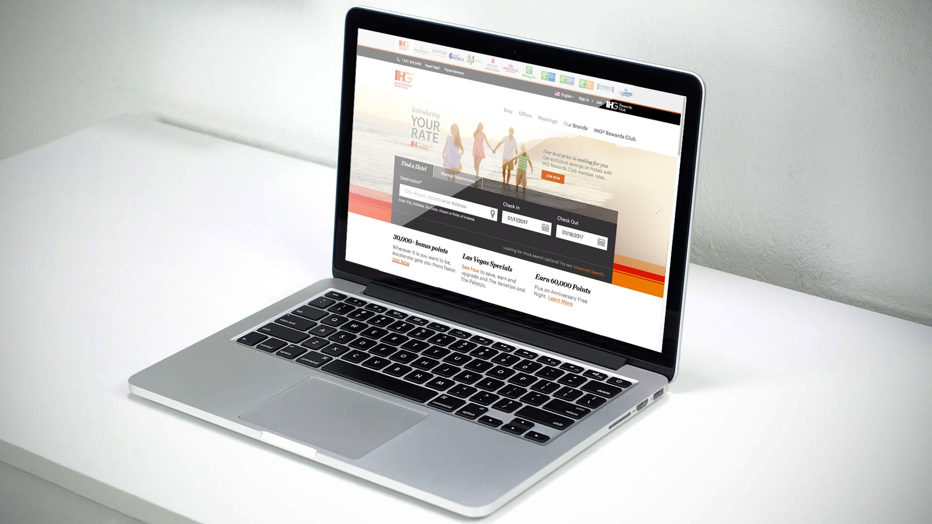 A computer featuring the homepage of ihg.com