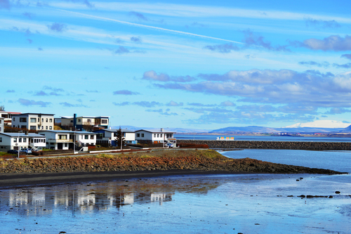 Cute Borgarnes town in Iceland at a fiord and sea reflection