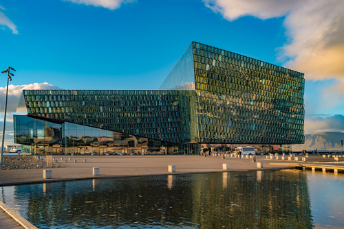 Reykjavik, Iceland - August 31, 2016 Harpa Concert Hall and Conference Centre in historical downtown in Reykjavik at warm Summer sunset in Iceland