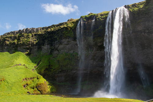 The Seljalandsfoss waterfall is located in the south of Iceland. The Seljalandsá river falls here 66 m deep and is fed by the glacier of Eyjafjallajökull.