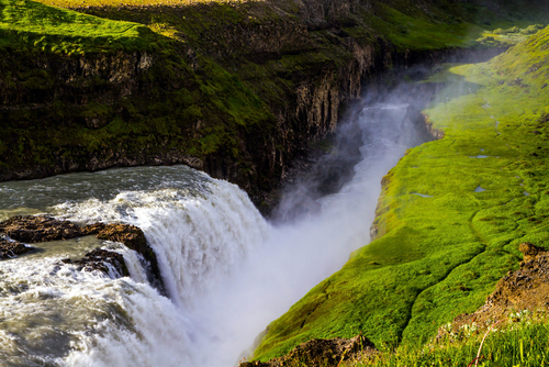 Southwest Iceland. The rumbling waterfall is fed by thawed glacial water. Gullfoss Golden Falls - the beautiful waterfall in Iceland, on the Hvita River. The concept of extreme and photo tourism