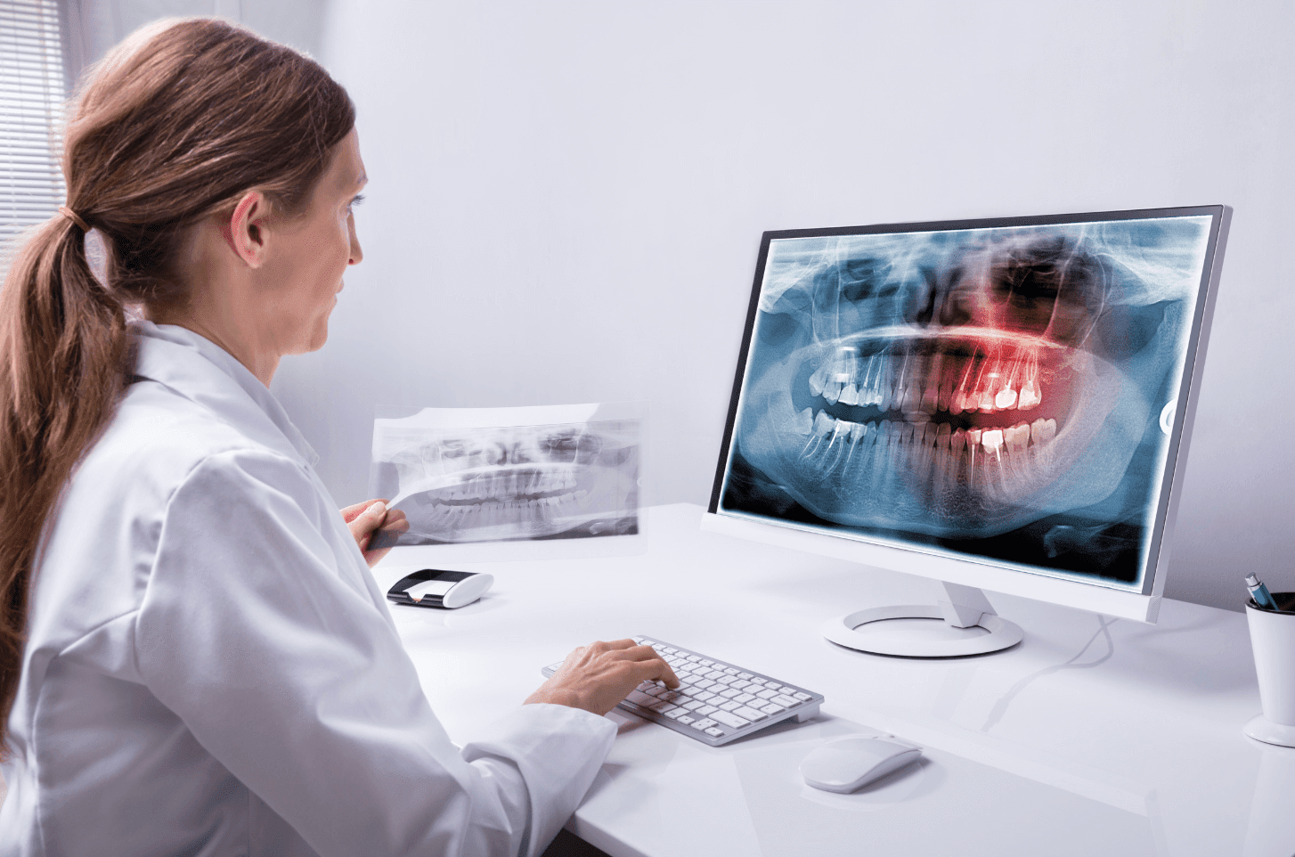 dentist reviewing dental x ray robinson