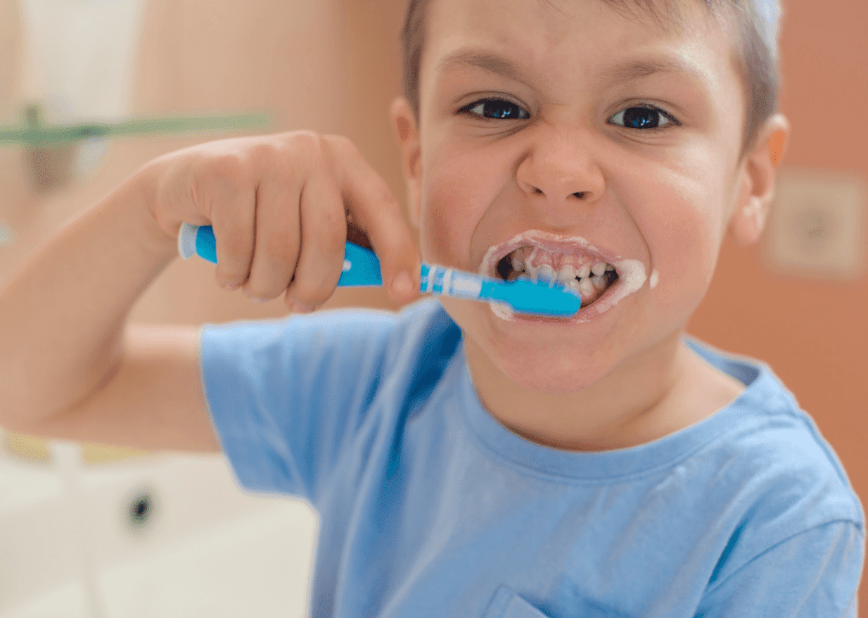 child boy brushing teeth