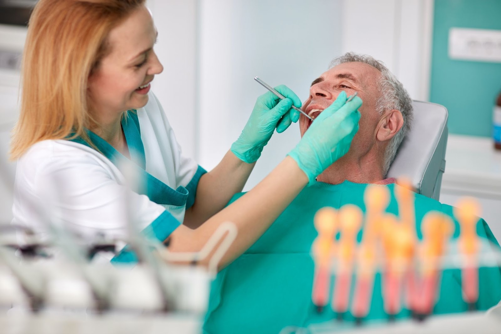 elderly man and dentist