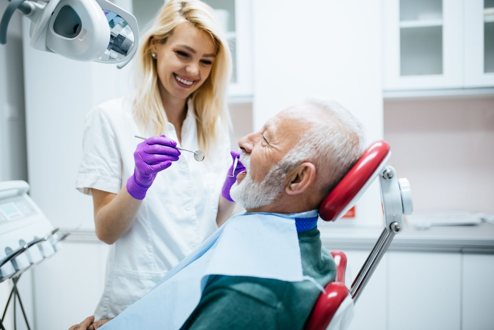 male elderly dental patient and female dentist