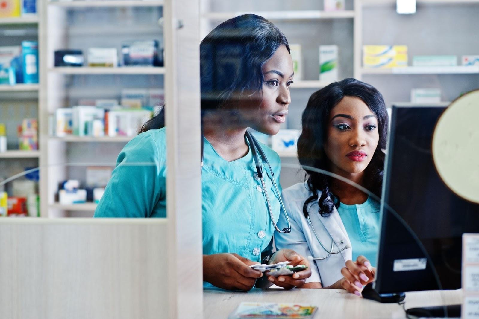 two female pharmacists