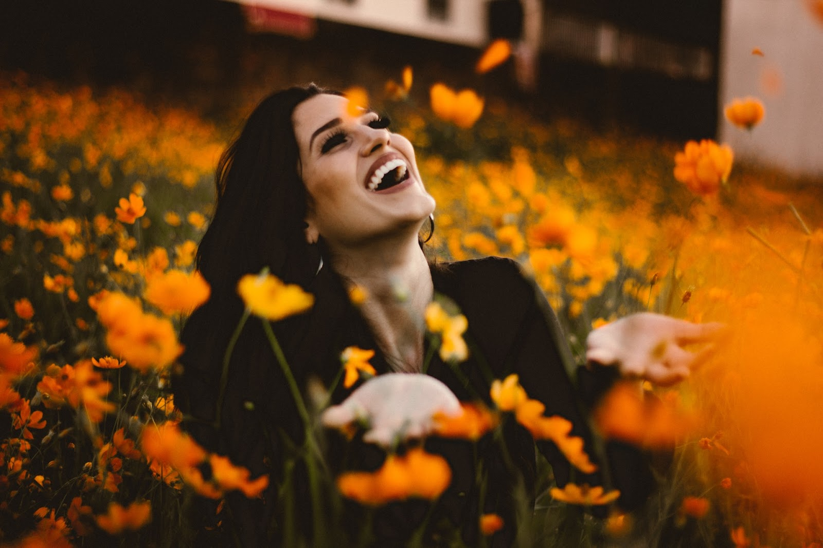 woman smiling in field of flowers