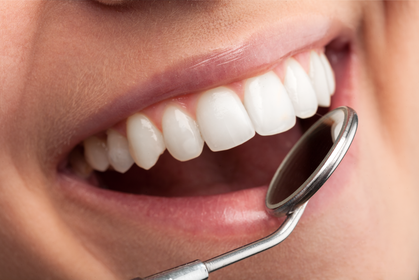dental tool near a smiling mouth