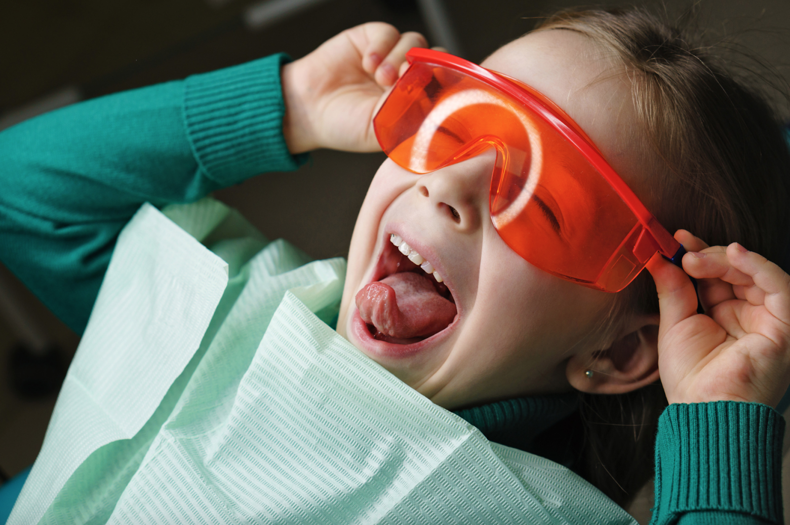 Smiling child wearing safety glasses