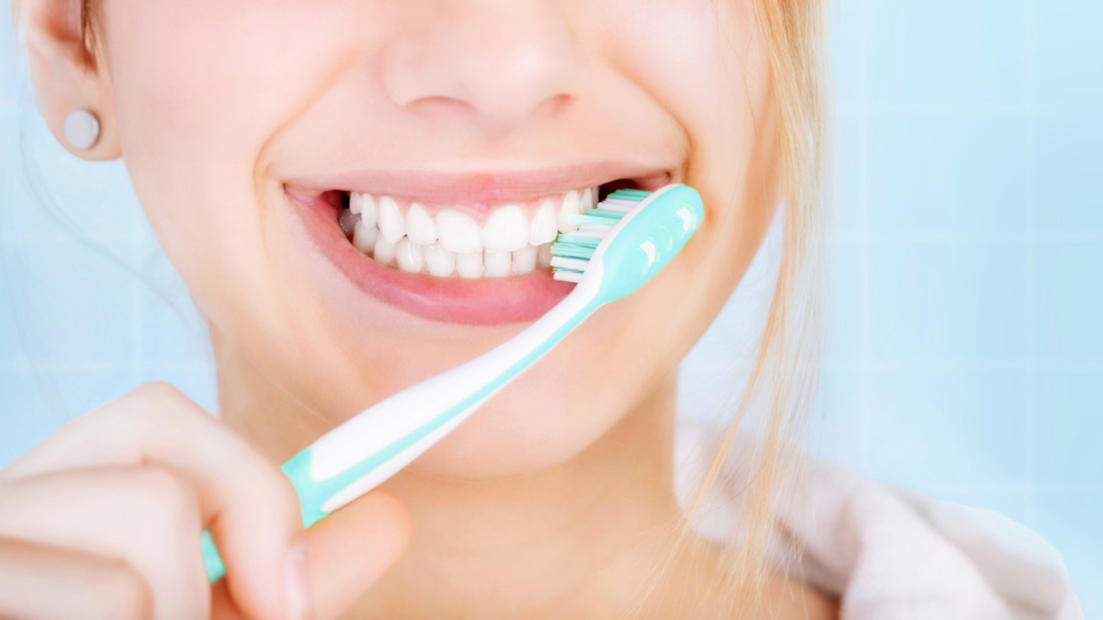 Closeup of girl brushing her teeth