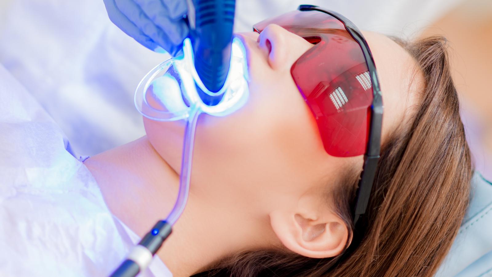 woman getting teeth whitened