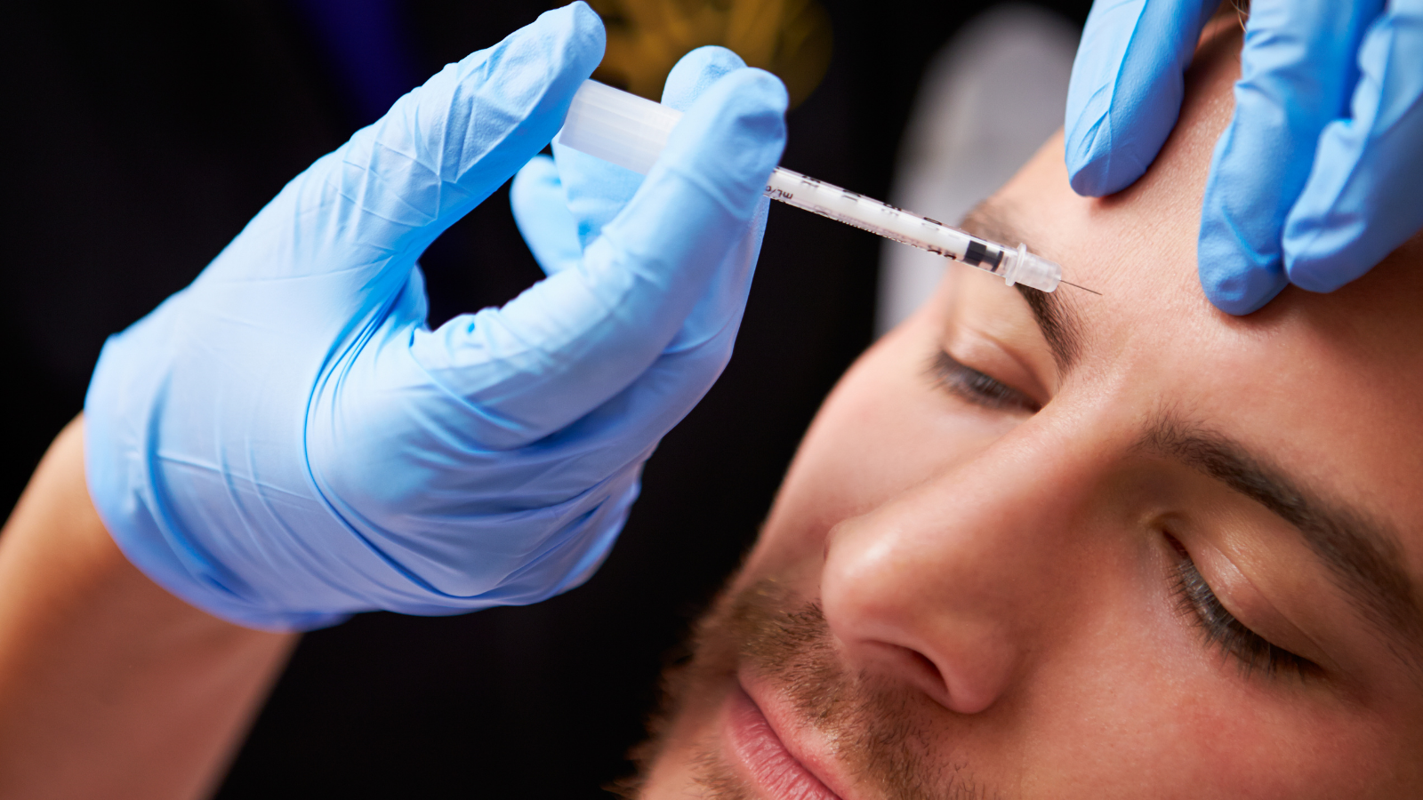 man getting botox injections