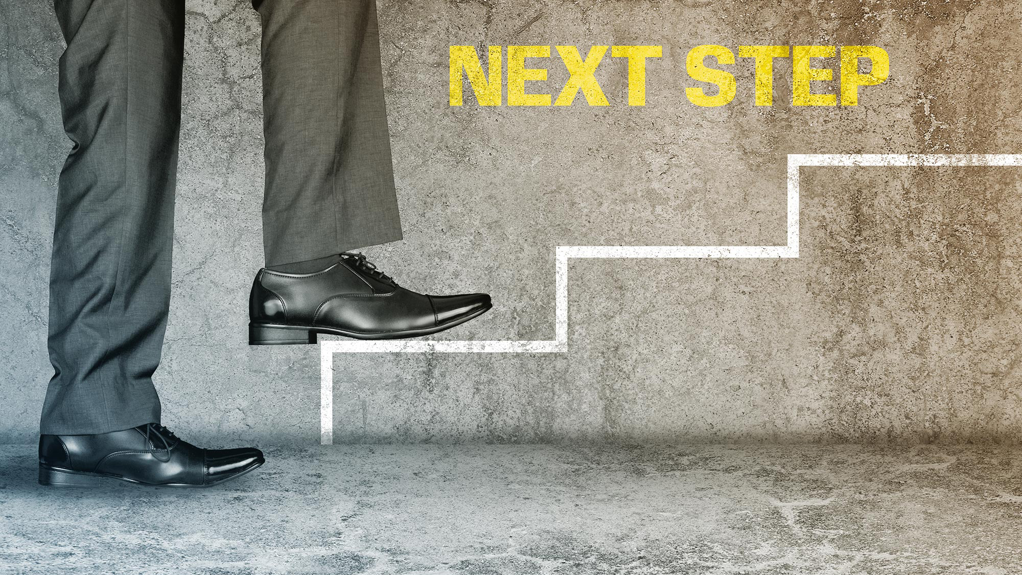 "Image of man's legs in gray dress pants and black dress shoes stepping upward on outline of stairs and the words ""next step"""
