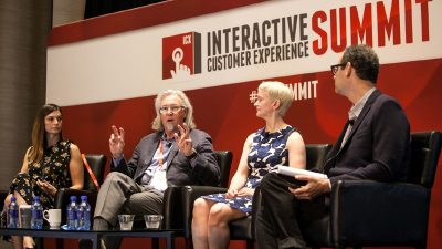 panel of speakers at ICX Summit