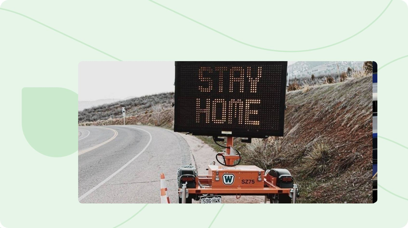 Stay Home Sign on Road