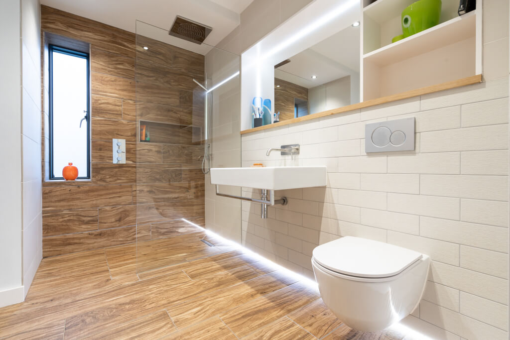 Modern bathroom with walk-in shower and perimeter lighting