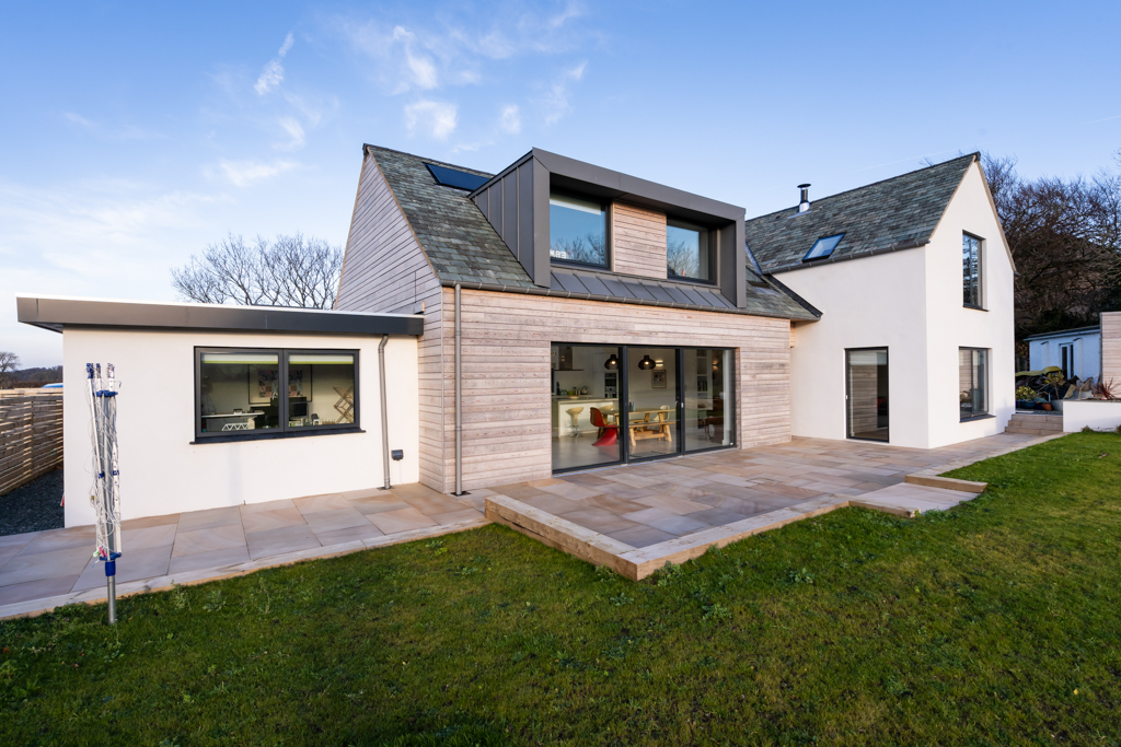 New build house with Timber cladding and sliding patio doors