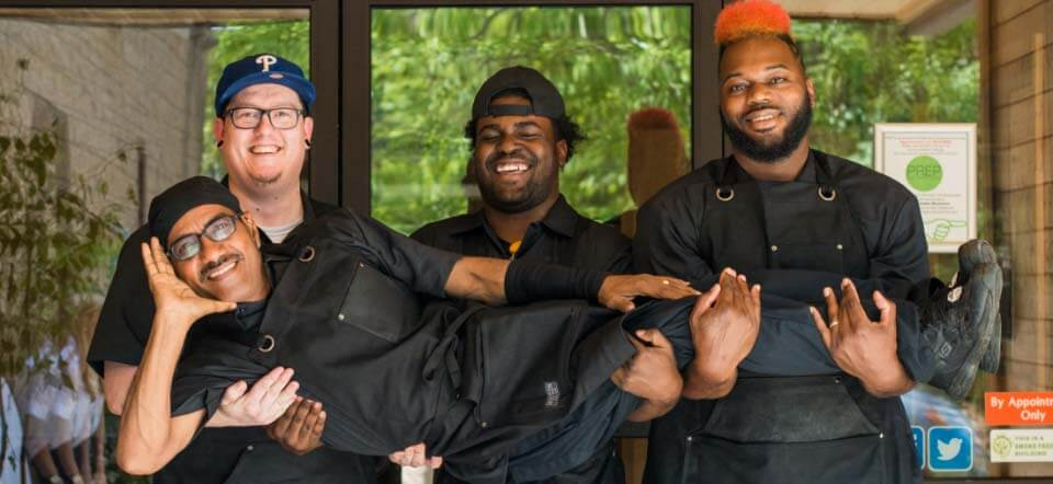 A group of chefs smiling